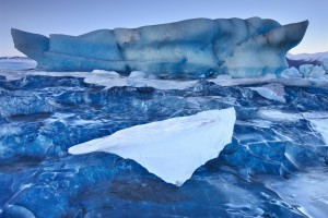 Crystal Blue Ice of an Iceberg.