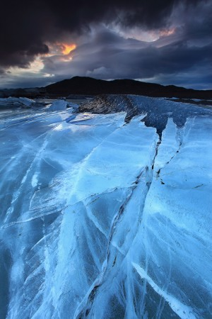 The relentless force of Svínafellsjökull pushing the ice sheet over a small iceberg.
