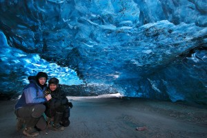 Örvar and Mai in a crystal cave in Vatnajökull ice cap.