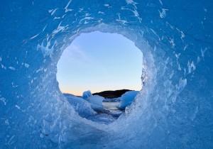 Jökulsárlón glacier lagoon seen through an ice hole.