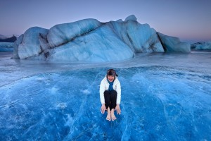 My wife posing as a model on a crystal blue iceberg.