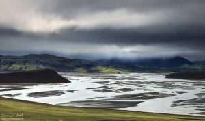 Dark skies over glacier river flood plains.
