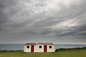 A lonely house on the edge of Dyrhóley sea cliff.