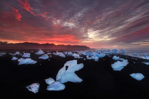 Stranded icebergs on a nearby beach during a spectacular sunrise.
