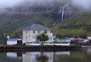 Waterfall fall into the backyard of the houses in Seyðisfjörður.