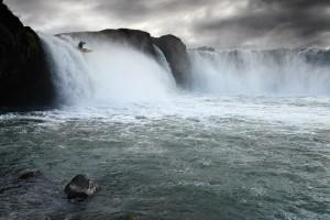 Kayak going off Goðafoss waterfall.