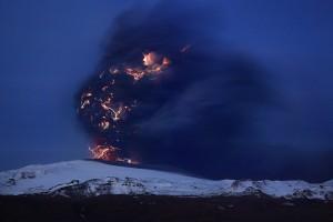 Lightning activity creating crackling clouds over Eyjafjallajökull volcano.