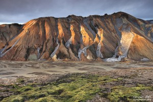 Rays of sun light up the ridges of Austurbarmur near Landmannalaugar.